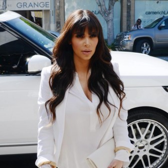 Kim Kardashian shops for baby clothes - still no love from Anna Wintour, Vogue.