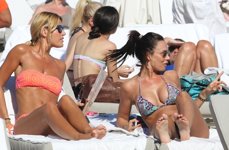 Nicole Minetti is on the beach with a girlfriend.