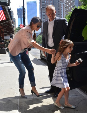 Katie Holmes and daughter Suri catch a ride.