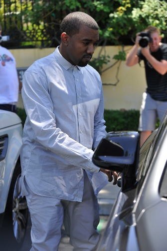 Kanye West heads for the car.
