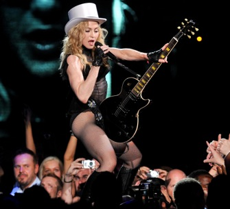 Madonna works over a guitar.